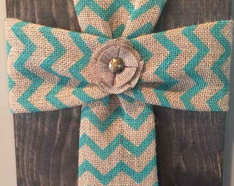 Fabric crosses on wood, with a fabric flower