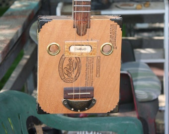 cigar box guitar 013, guitar, gift ideas, mens gift ideas, musicians gift ideas, new products, trending gifts, hand made gifts, special gift