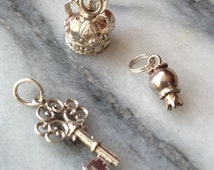 Three vintage sterling silver charms