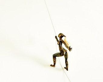Woman Climbing Sculpture Wall Art