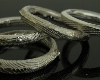 Irregular rings  in sterling silver made with the melting with cuttlefish bone