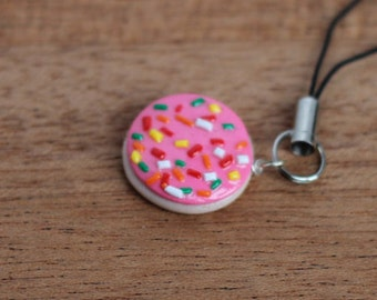 Pink frosted sugar cookie with sprinkles necklace.