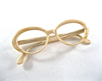white woodgrain circular eyeglass frames. 1960s cream oval cat eye glasses. new old stock/NOS/deadstock.