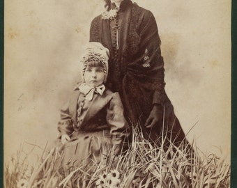 Cabinet Card of Mother and Child in studio field of flowers