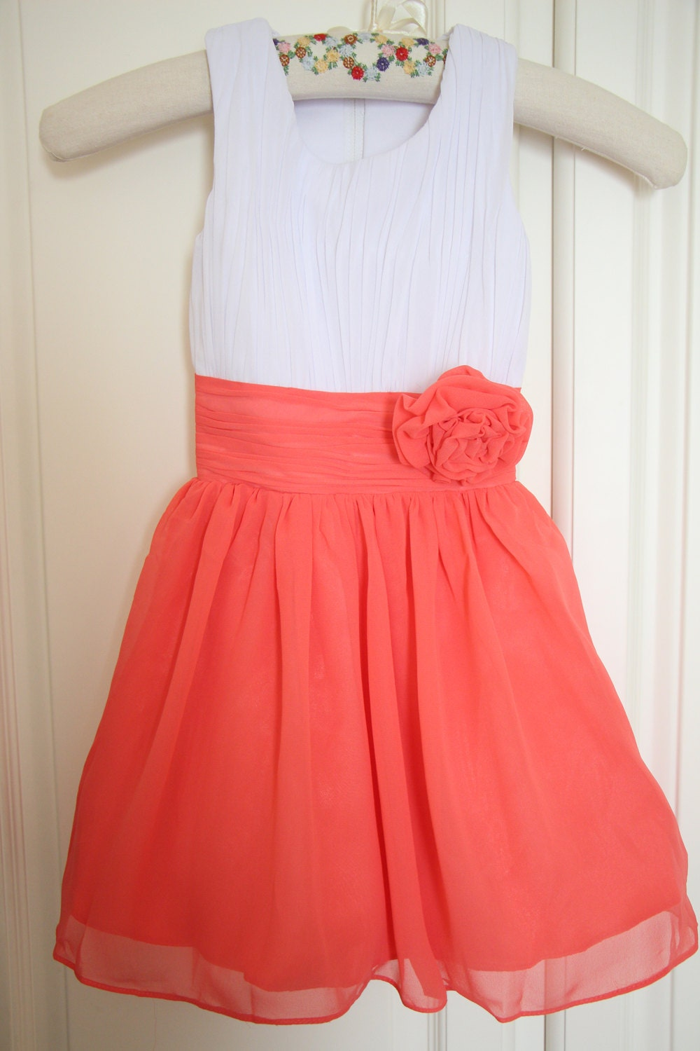 Corals, Peaches, Oranges; Flower Girl Dress Style CORAL One Shoulder Satin and Organza Dress with Sequin Bodice. $ $ Coral. Girls Dress Style Sleeveless Lace Dress with Flower and Sash in Choice of Color. $ $ Choice of Coral or Jade.