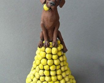 Chocolate Labrador Retriever Dog on Pile of Tennis Balls Sculpture - Abundance