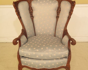23680E: Heavily Carved French Style Walnut 1920's Wing Back Chair