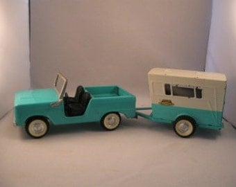 Vintage Ford Bronco and Vacationer Trailer