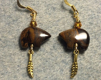 Dark brown tiger iron gemstone Zuni bear fetish bead earrings adorned with tiny gold feather charms and amber crystal beads.