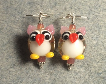 Pink and white lampwork owl bead earrings adorned with pink Czech glass beads.