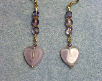 Violet Czech glass heart bead dangle earrings adorned with violet Czech glass beads.