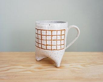 Grid mug with three feet by Mud to Life