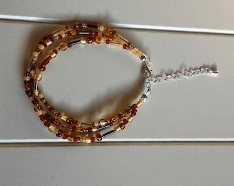 Amber coloured multi-strand beaded bracelet