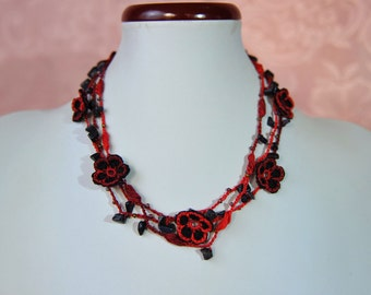 Red cotton crochet necklace with black flowers and natural stones black