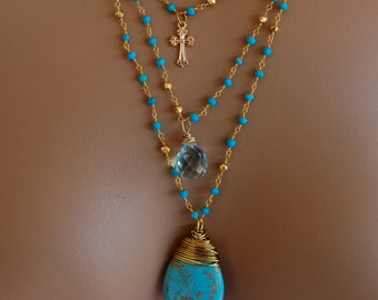 Sleeping Beauty Turquoise pendant, blue quartz, gold filled cross necklace, turquoise and pyrite rosary chain. Multi strand rosary necklace