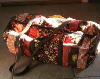 Brown and Orange Flowered Duffle Bag