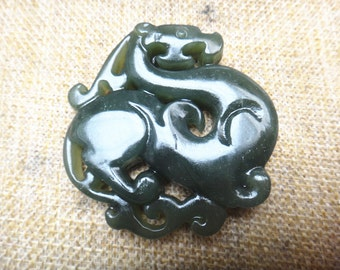 Natural  jasper  hollow carved Chinese jade dragon pendant