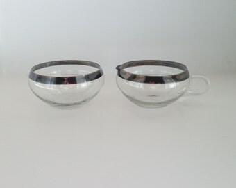Low profile silver rimmed glass cream and sugar set