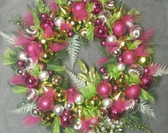 Christmas ornament wreath. Pink, green and silver sparkly Christmas.