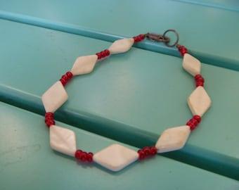 Red and white beaded bracelet