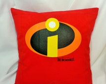 The Incredibles cotton t-shirt made into a pillow cover. Superhero bedding made from a red shirt with the Incredibles logo on it.