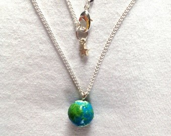 Planet Earth Necklace on a sterling silver chain.