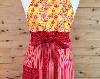 Apron kitchen for woman. Reversible. Apron for child available. Reasons vegetables, spirals, stripes. Yellow, orange, red.
