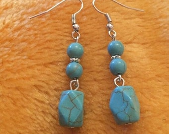 Turquoise blue howlite silver dangly earrings