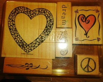6 Rubber stamps by various companies, in excellent condition, looks to have been lightly used, 2 hearts,2 boarders,dream,peace sign