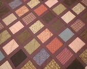 homemade quilt top, size 56x86, plum, etc