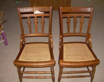 2 Antique hand caned chairs, with newly recaned seats.