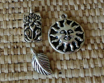 Misc. Charms 1 - Silver and Pewter: Charms for Bracelets, Sun/Moon,/Cross,/Om/Tree of Life/Wine Glass/Heart/Lotus/Leaf
