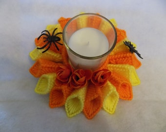 orange, yellow candle holder/