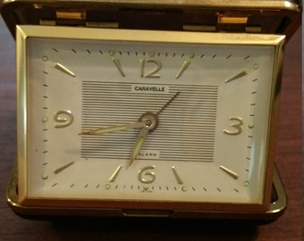 Caravelle by Bulova Travel alarm. Glow in the dark hands. Case made in Japan. 1972