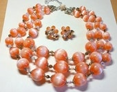 Vibrant vintage Vendome from Coro vintage demi parue jewelry set with orange moonglow Lucite and crystal beads multistrand necklace earrings