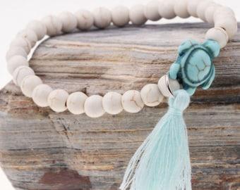 White Beaded Bracelet with Blue Turtle