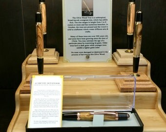 Olivewood Wall Street Design Pen with a black & gold finish. Uses a Parker refill.