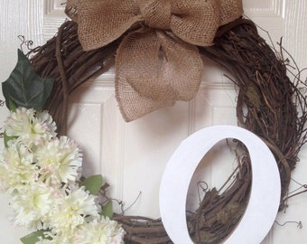 Country style tree branch wreath customized with monogram letter and flowers