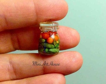 Miniature pickles in a jar with a glass lid