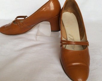 Miss Holmes tan patent Mary-Janes