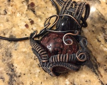 Wonderful Lovely copper wire wrapped glass implosion pendant