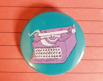 Typewriter pin badge