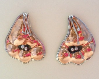 Copper and silver flower post earrings.