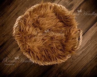 Brown fur in a basket newborn digital backdrop background on a wood floor