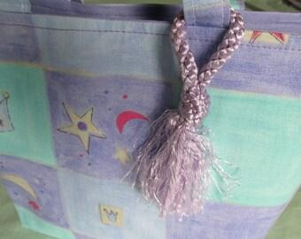 Pretty fabric handbag with a tassel!