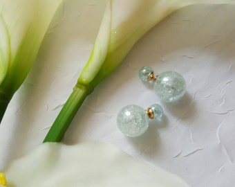 Double sided clear color in gliters stud earring.