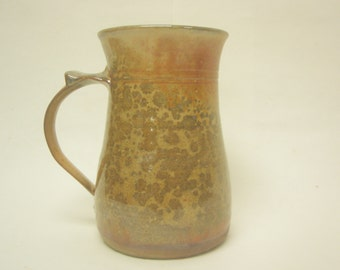 Wheel thrown Stoneware mug. Shino glazed