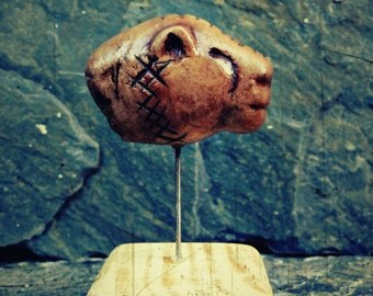 Cave lion head, restitution of a paleolithic figurine