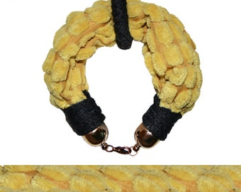 Fabric bracelet with yellow center circle