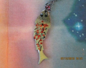 copper enameling fish necklace with swirls of orange and black